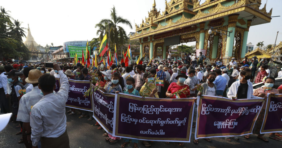 "Supporters of the Myanmar military and the military-backed Union Solidarity and Development Party hold placards that read, ""Do not accept interference by foreign countries. Wipe out those relying on external elements,"" as they protest election results during a rally near Shwedagon pagoda in Yangon on Saturday."