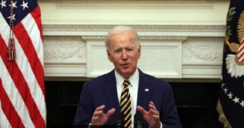 President Joe Biden speaks Friday in the State Dining Room of the White House.