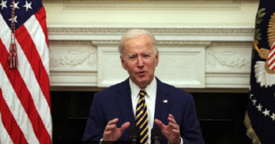 President Joe Biden speaks Friday in the State Dining Room of the White House.