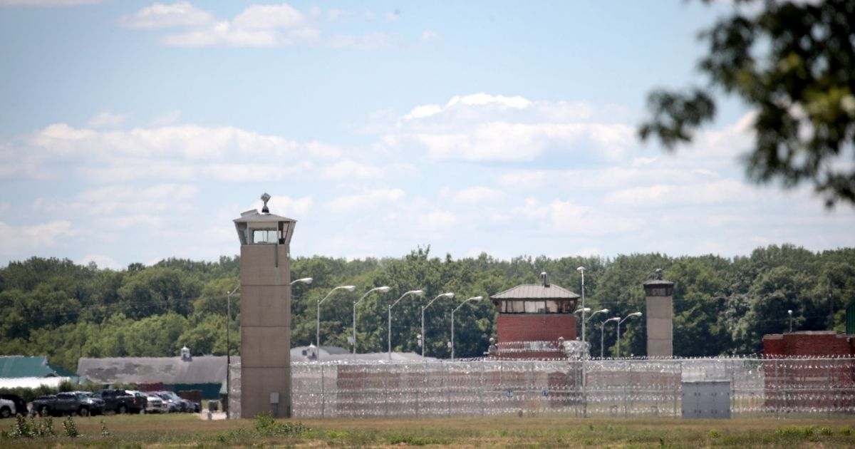 A guard tower stands along a security fence at the Federal Correctional Complex on July 13, 2020, in Terre Haute, Indiana.