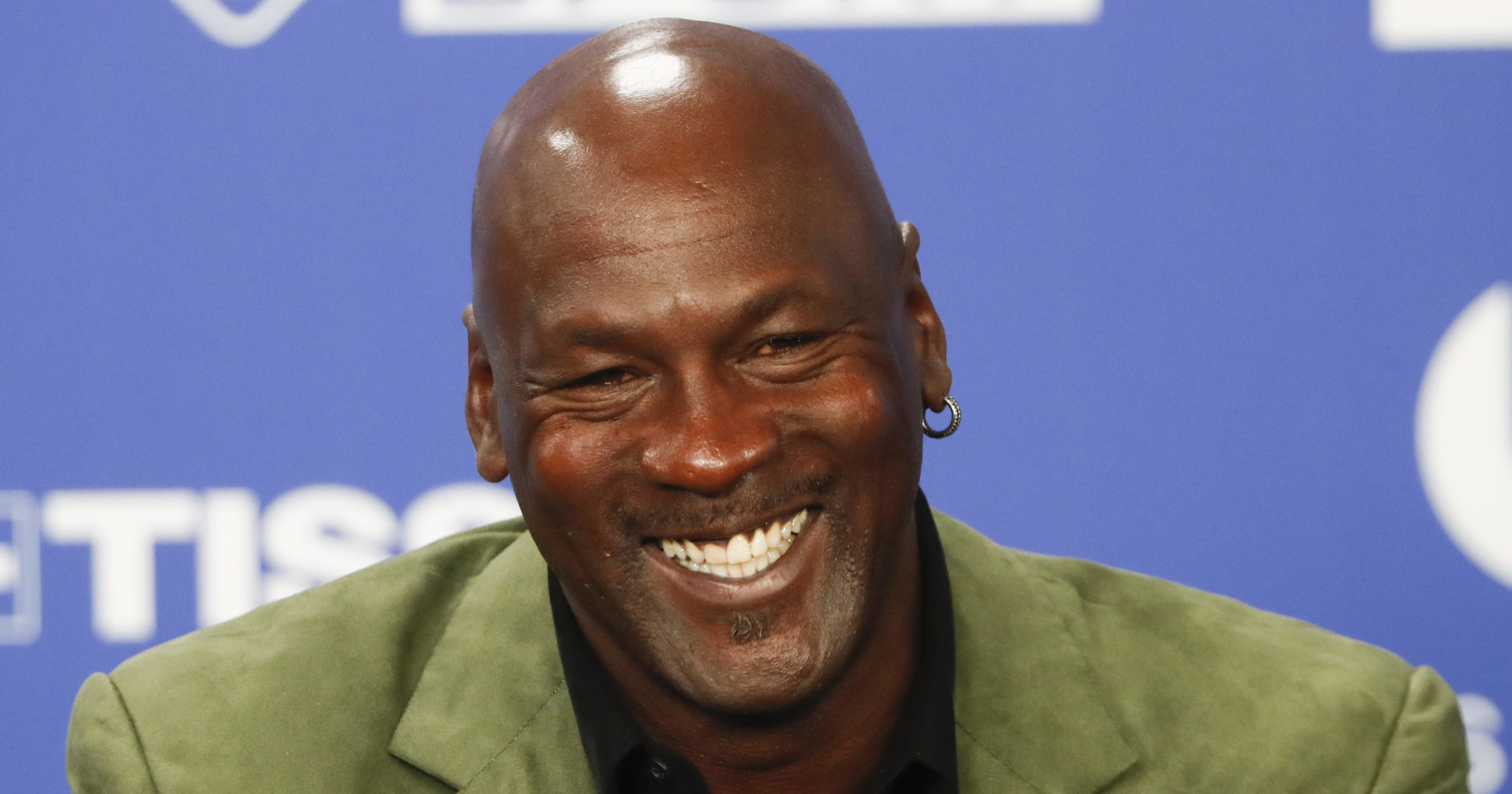 Basketball legend Michael Jordan speaks during a news conference ahead of an NBA basketball game between the Charlotte Hornets and Milwaukee Bucks in Paris, in this Jan. 24, 2020, file photo. Jordan is donating $10 million to launch two medical clinics in underserved communities near his hometown in North Carolina, a regional health care system announced Monday.