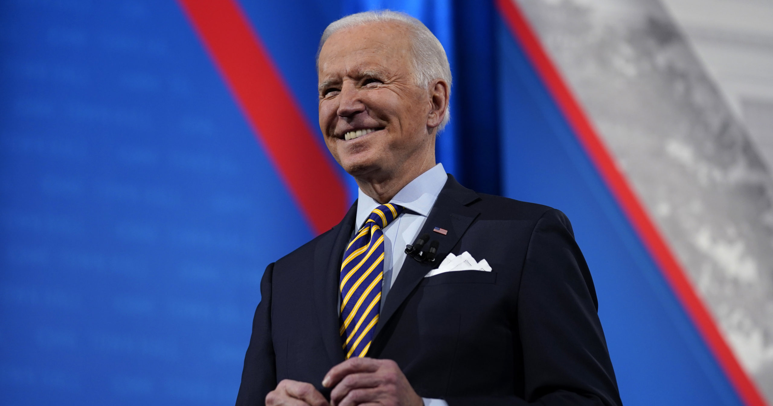 President Joe Biden stands on stage during a televised town hall event at Pabst Theater on Feb. 16, 2021, in Milwaukee.
