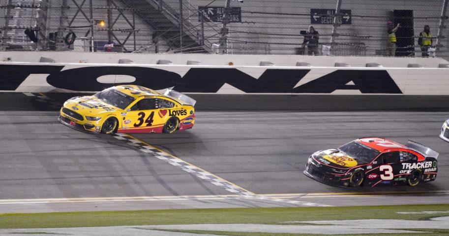 Michael McDowell crosses the finish line ahead of Austin Dillon to win the NASCAR Daytona 500 auto race at Daytona International Speedway on Monday in Daytona Beach, Florida.