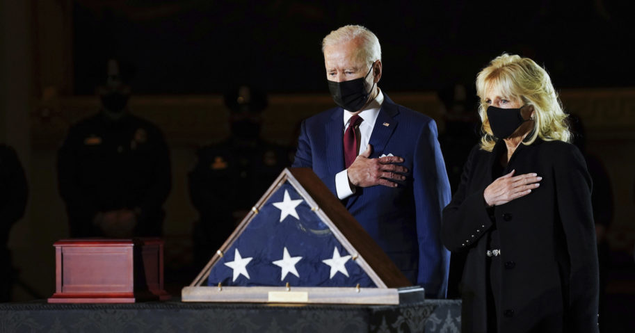 President Joe Biden and first lady Jill Biden pay their respects to the late US Capitol police officer Brian Sicknick at the Capitol Rotunda on Feb. 2, 2021, in Washington, D.C.