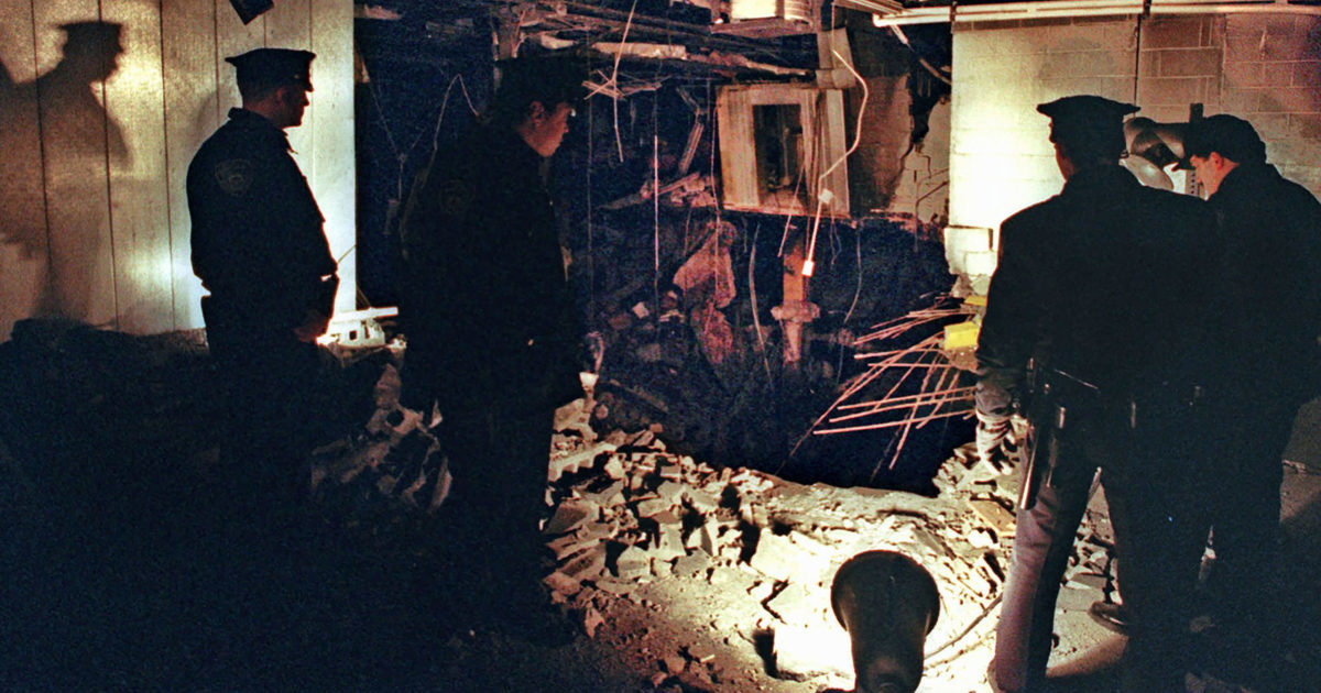 Port Authority and New York City Police officers view the damage caused by a truck bomb