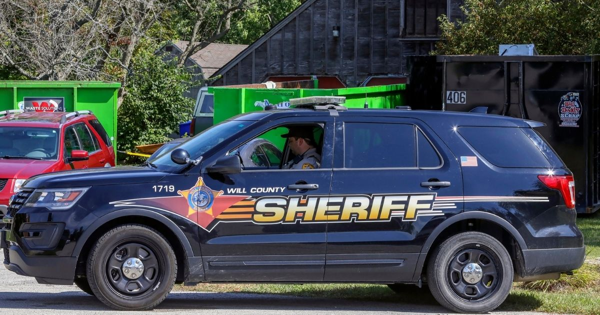 A Will County Sheriff's Office patrol car is stationed outside the home of Ulrich Klopfer in unincorporated Crete, Illinois, on Sept. 19, 2019.