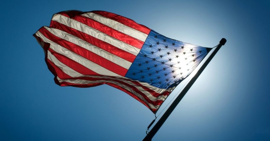 An American flag is pictured in the stock image above.