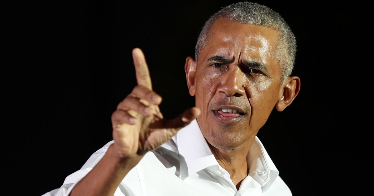 Former President Barack Obama campaigns for Joe Biden during a drive-in rally at Florida International University in Miami on Nov. 2.
