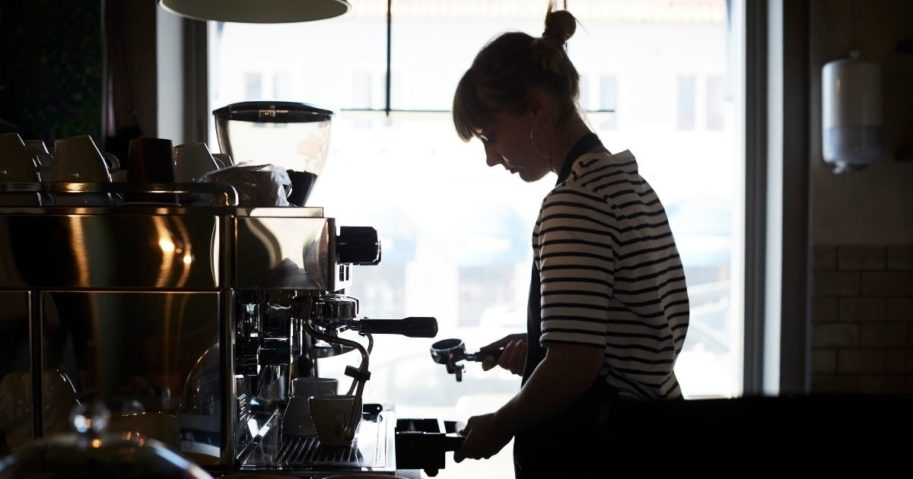 This stock photo portrays a lone barista manning a coffee shop counter. One coffee shop in Arizona is being praised for raising the minimum wage for their employees, though many other small businesses will likely be unable to follow suit.