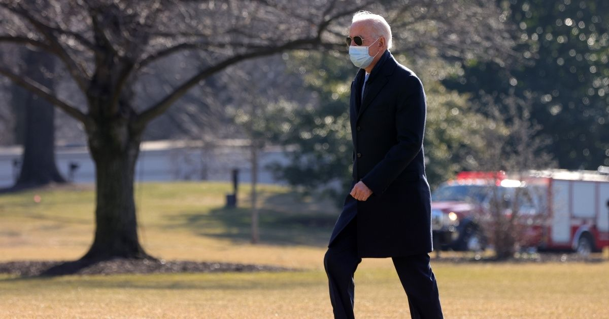 President Joe Biden walks on the South Lawn toward the residence after he landed at the White House on Monday in Washington, D.C.