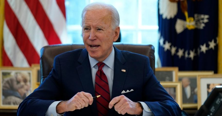 President Joe Biden signs a series of executive orders in the Oval Office of the White House on Thursday.