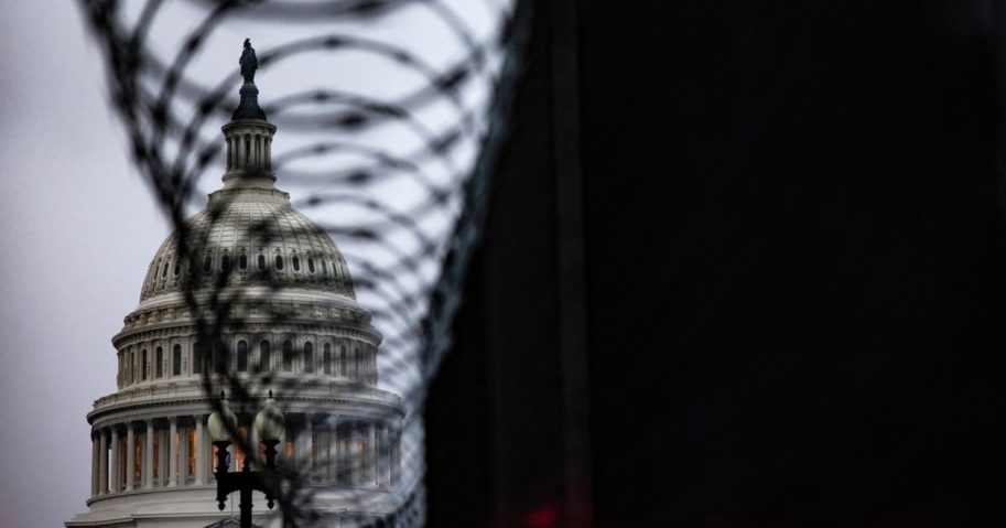 The U.S. Capitol dome is seen past security fencing and razor wire set up around Capitol Hill following the Jan. 6 Capitol incursion in Washington, D.C., on Thursday.