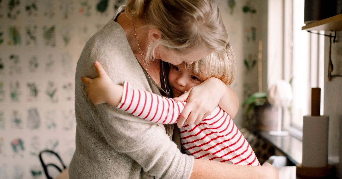 This stock photo portrays a small child hugging their mother. A government minister in the United Kingdom has said citizens cannot hug one another until May 17, in order to curb the spread of COVID-19.