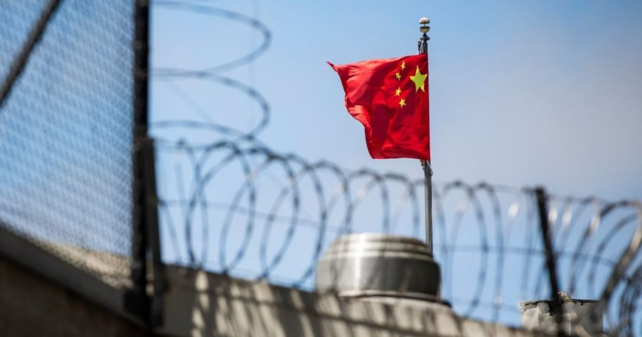 The flag of the People's Republic of China flies behind barbed wire at the Consulate General of the People's Republic of China in San Francisco on July 23, 2020.