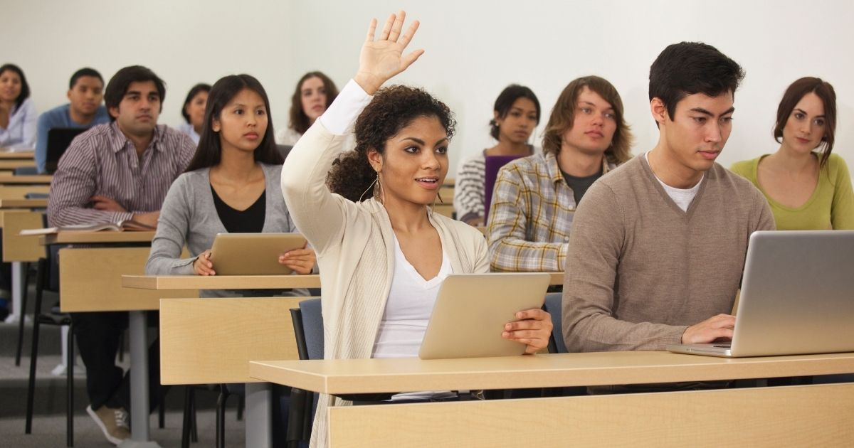 The above stock photo shows students in a classroom.