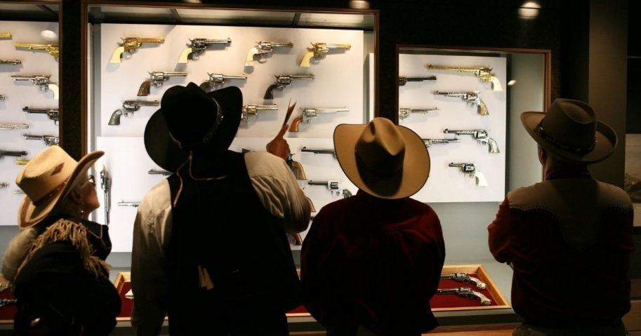 """The crowd gathers in the newly opened exhibit """"The Colt Revolver in the American West"""" during the Day of the Cowboy and Cowgirl at the Autry National Center on July 23, 2011, in Los Angeles."""