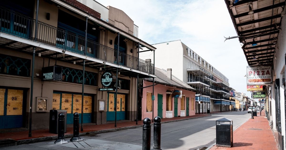 Typically filled with people, Bourbon Street in New Orleans is seen nearly empty on April 23, the first day of Jazz Fest 2020, after Mayor Latoya Cantrell recommended the cancellation of all festivals and large events in the city because of COVID-19.
