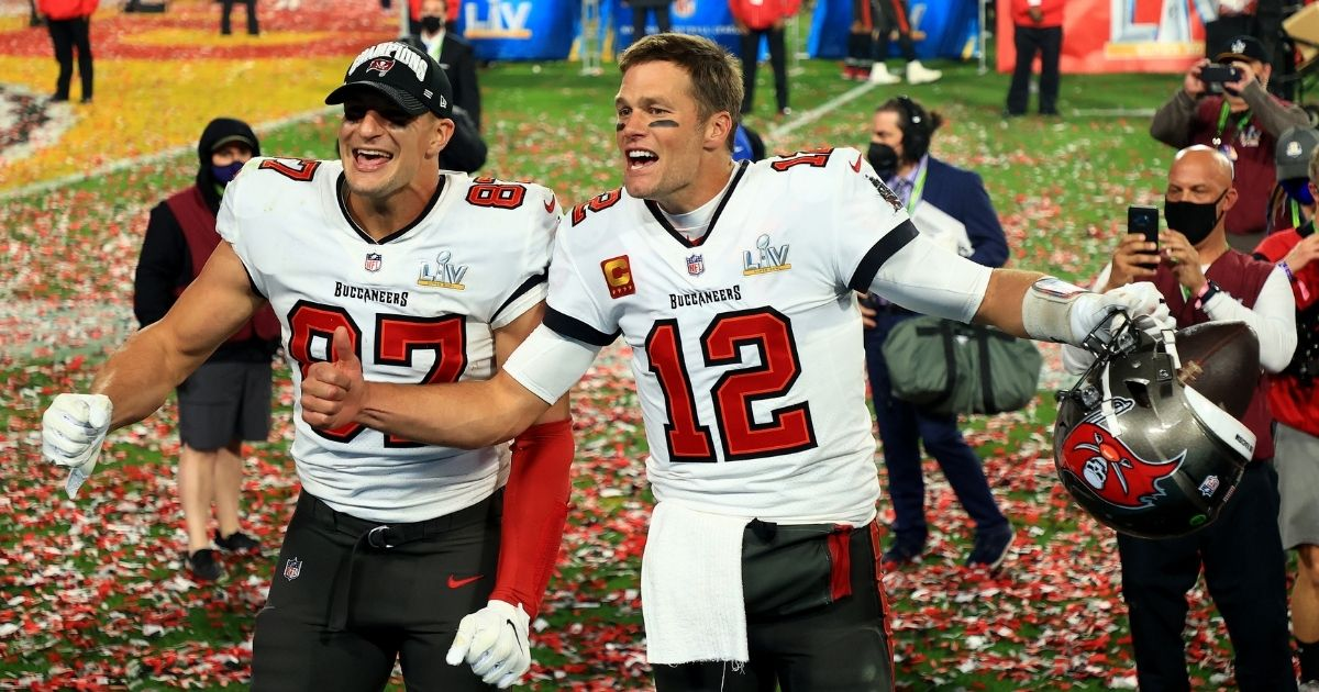 Rob Gronkowski, left, and Tom Brady celebrate after the Tampa Bay Buccaneers beat the Kansas City Chiefs in Super Bowl LV at Raymond James Stadium on Sunday.