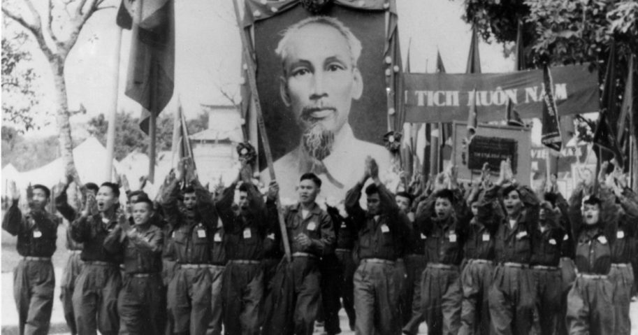 Uniformed students carry a portrait of Vietnamese President Ho Chi Minh during parade in Hanoi, Vietnam, in 1965.