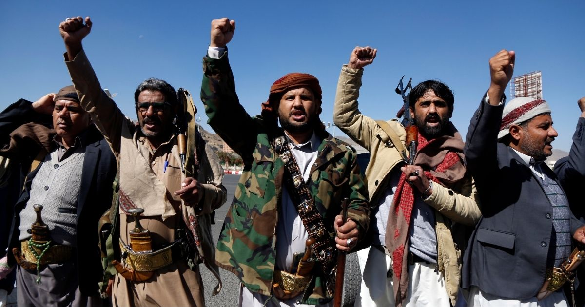 Yemen's Houthi supporters shout slogans as they take part in a gathering on Thursday in Sana'a, Yemen.