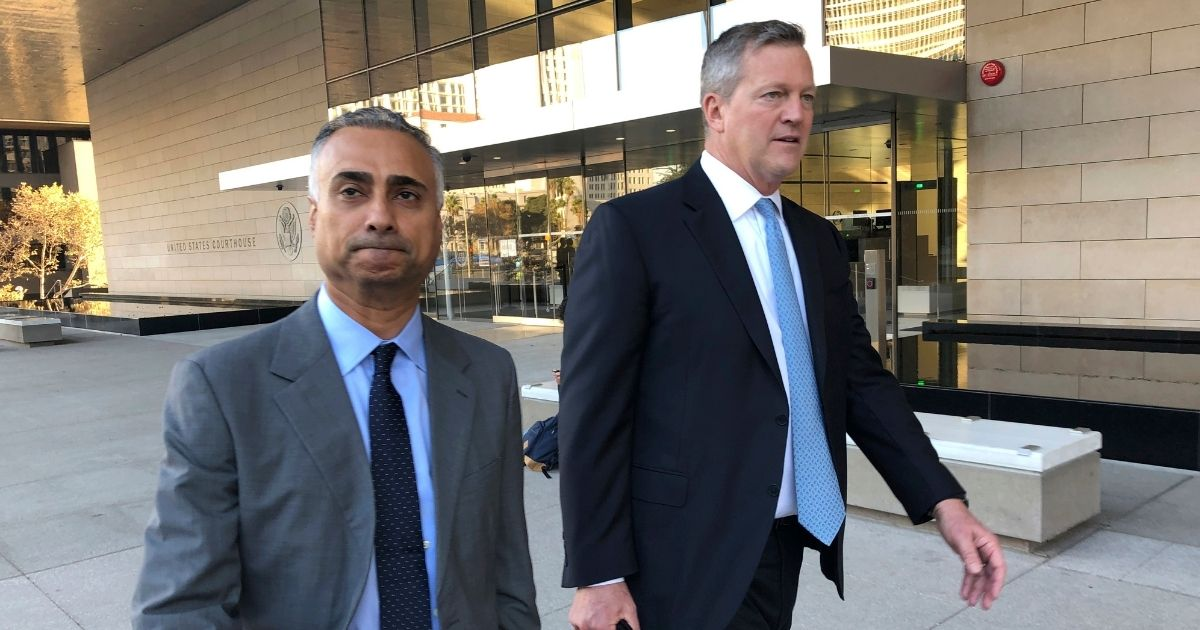 Imaad Zuberi, left, leaves the federal courthouse with his attorney Thomas O'Brien, right, in Los Angeles on Nov. 22, 2019. Zuberi pleaded guilty to funneling donations from foreigners to U.S. political campaigns.