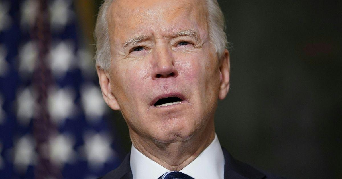 President Joe Biden speaks in the State Dining Room of the White House in Washington on Jan. 27.