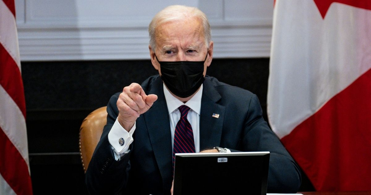President Joe Biden participates in a virtual bilateral meeting with Prime Minister Justin Trudeau of Canada in the Roosevelt Room of the White House in Washington, D.C., on Tuesday.