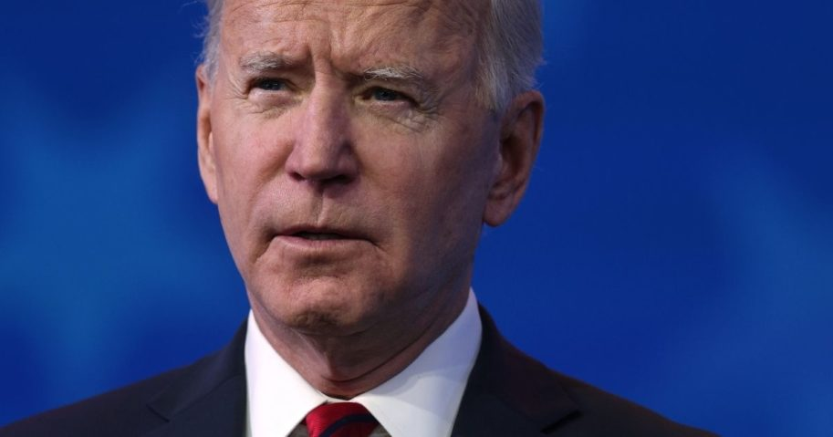 Then-President-elect Joe Biden speaks during day two of laying out his plan to combat the coronavirus at The Queen theater on Jan. 15, 2021, in Wilmington, Delaware.