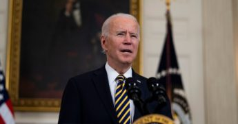 President Joe Biden speaks at an event to sign an executive order on the economy with Vice President Kamala Harris on Wednesday in the State Dining Room of the White House in Washington, D.C.