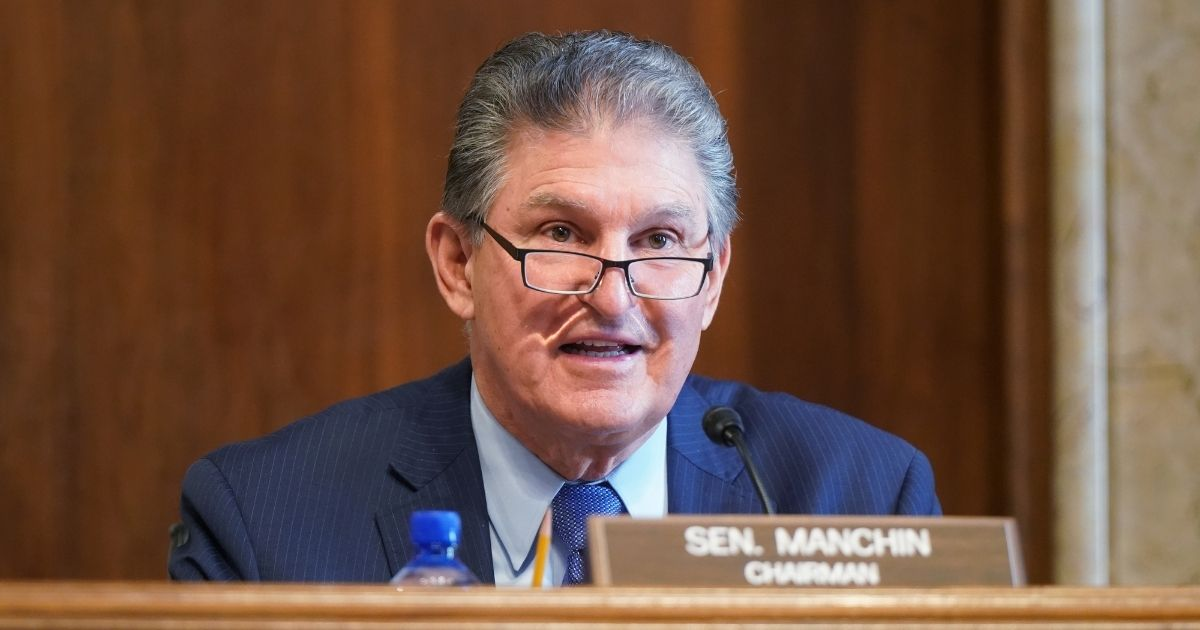 Democratic Sen. Joe Manchin of West Virginia, chairman of the Senate Committee on Energy and Natural Resources, gives opening remarks at the confirmation hearing for Rep. Deb Haaland of New Mexico, President Joe Biden's nominee for secretary of the interior, on Wednesday in Washington, D.C.