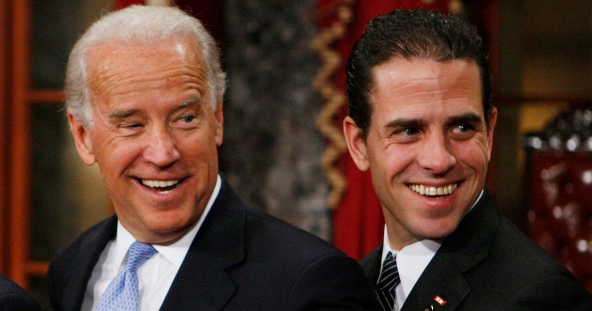 Then Vice President-elect Joe Biden and his son Hunter smile during an event in the Old Senate Chamber on Capitol Hill in Washington on Jan. 6, 2009.
