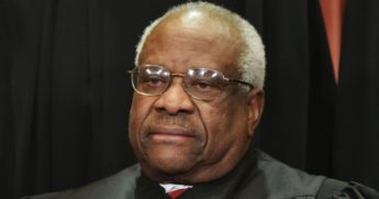 Associate Justice Clarence Thomas poses for the official group photo at the U.S. Supreme Court in Washington on Nov. 30, 2018.