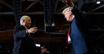 Then-President Donald Trump, right, opens his arms to Rush Limbaugh as he arrives to speak during a rally at the Show Me Center in Cape Girardeau, Missouri, on Nov. 5, 2018.