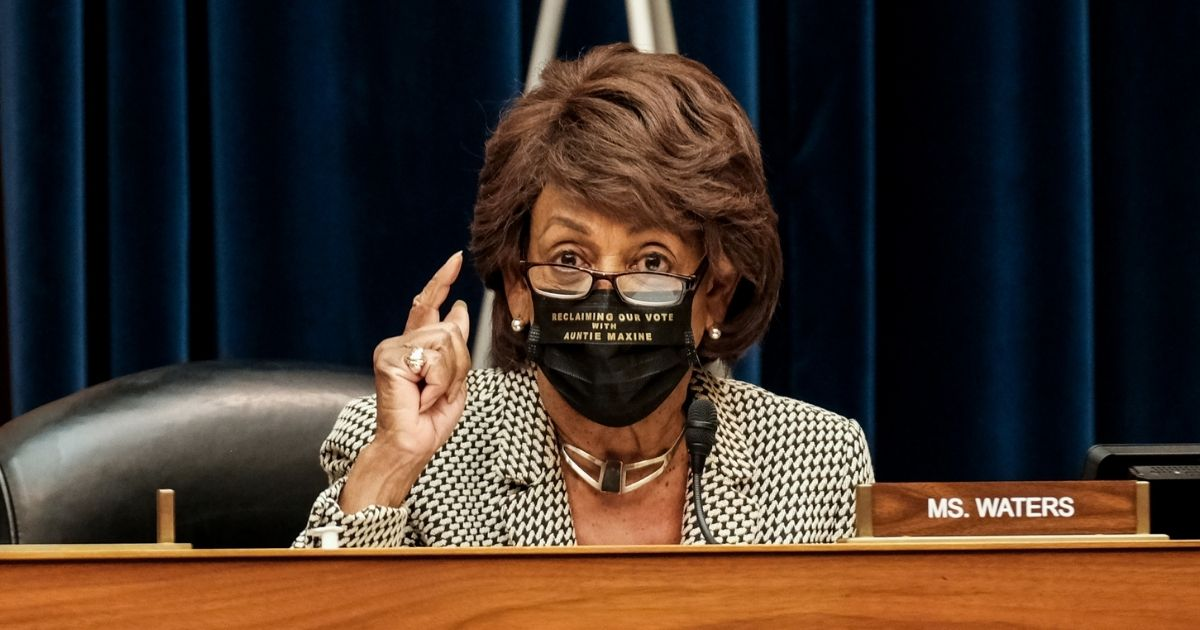 Democratic Rep. Maxine Waters of California listens to Health and Human Services Secretary Alex M. Azar at a hearing before the House Select Subcommittee on the Coronavirus Crisis on Oct. 2, 2020, in Washington, D.C.
