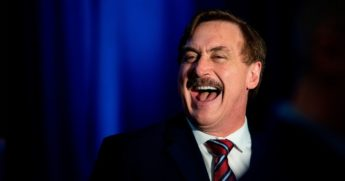 "MyPillow CEO Mike Lindell laughs during a ""Keep Iowa Great"" media conference in Des Moines, Iowa, on Feb. 3, 2020."