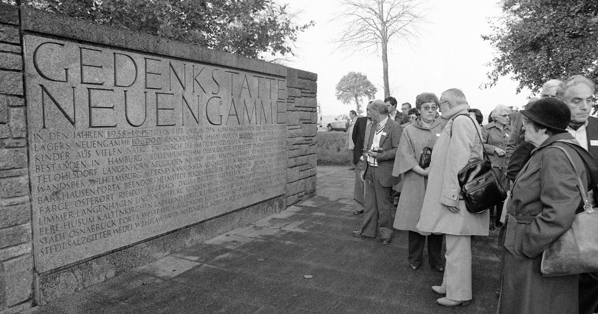 Former French inmates of the Neuengamme Nazi concentration camp arrive at the camp site in Hamburg, Germany, on Oct. 17, 1981, to attend the opening ceremony for the new documentation center to be held the next day.