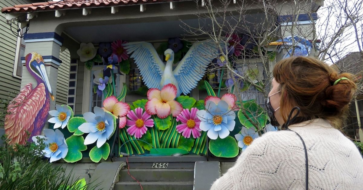 Designer, Caroline Thomas looks at a house decorated like a parade float in New Orleans on Jan. 8, 2021.