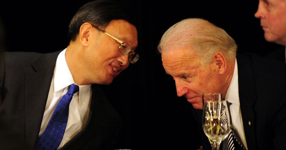 Yang Jiechi, left, then China's foreign minister, has a word with then-Vice President Joe Biden during a luncheon in Los Angeles on Feb. 17, 2012.