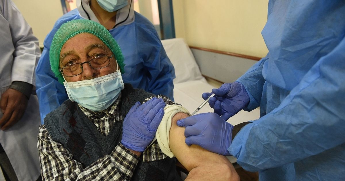 A doctor receives a dose of the Chinese-made Sinopharm COVID-19 vaccine at a vaccination center in Pakistan on Feb. 3, 2021.