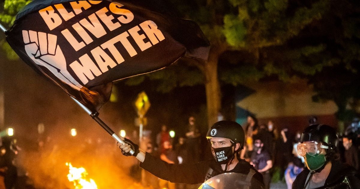 Protesters gather in front of a fire near a police precinct on Sept. 6, 2020, in Portland, Oregon.