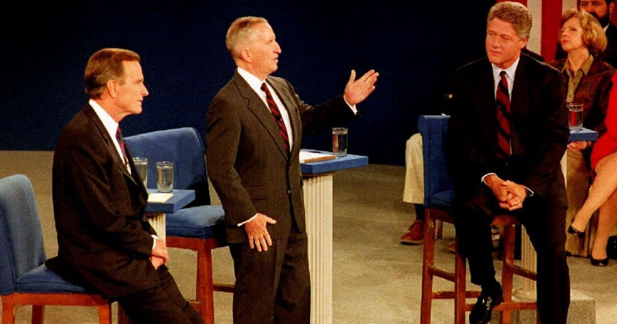 Then-presidential candidate Bill Clinton, right, and then-President George H.W. Bush, left, listen as Independent presidential candidate Ross Perot answers a question on Oct. 15, 1992, at the University of Richmond in Richmond, Virginia.