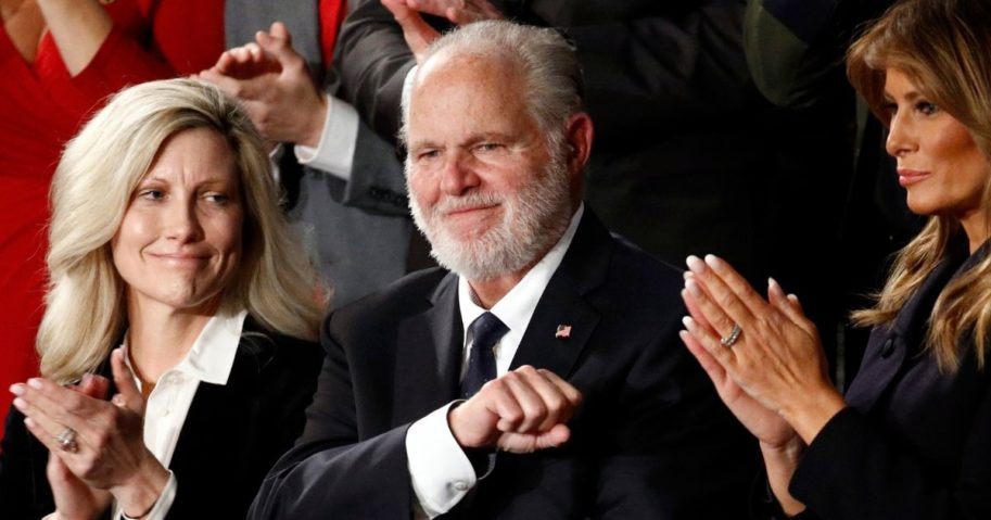 Rush Limbaugh reacts as his wife, Kathryn, left, and Melania Trump applaud after then-President Donald Trump honored him during his State of the Union address on Capitol Hill in Washington on Feb. 4, 2020.