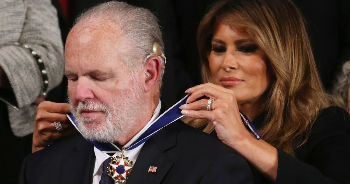 Radio personality Rush Limbaugh reacts as then-first lady Melania Trump gives him the Presidential Medal of Freedom during the State of the Union address in the chamber of the U.S. House of Representatives on Feb. 4, 2020, in Washington, D.C.