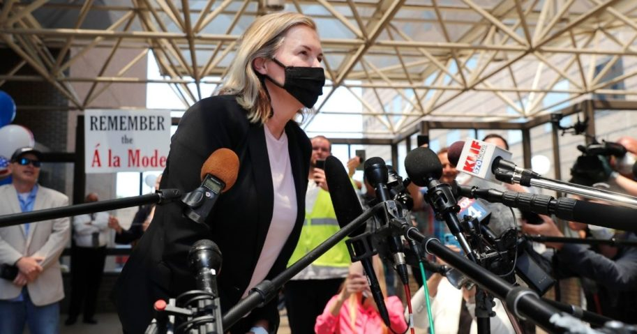 Salon owner Shelley Luther leans in to speak to the media and supporters after she was released from jail in Dallas on May 7, 2020.