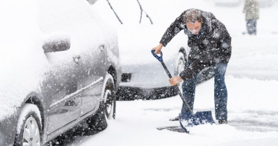 A man shoveling snow off a driveway is pictured in the stock image above.
