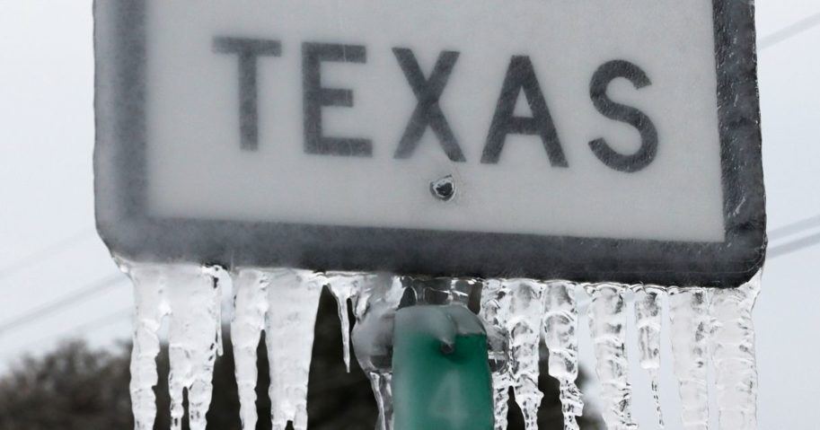 Icicles hang off a State Highway 195 sign in Killeen, Texas, on Thursday.