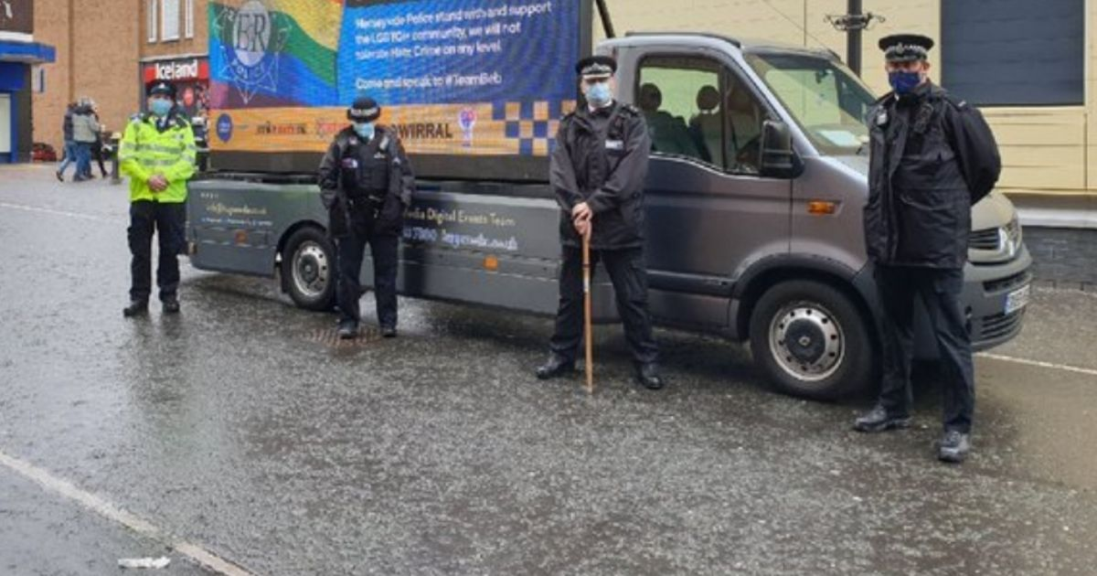 """The message was juxtaposed with a large rainbow flag and accompanied by text that read, """"Merseyside Police stand with and support the LGBTQ+ community."""""""