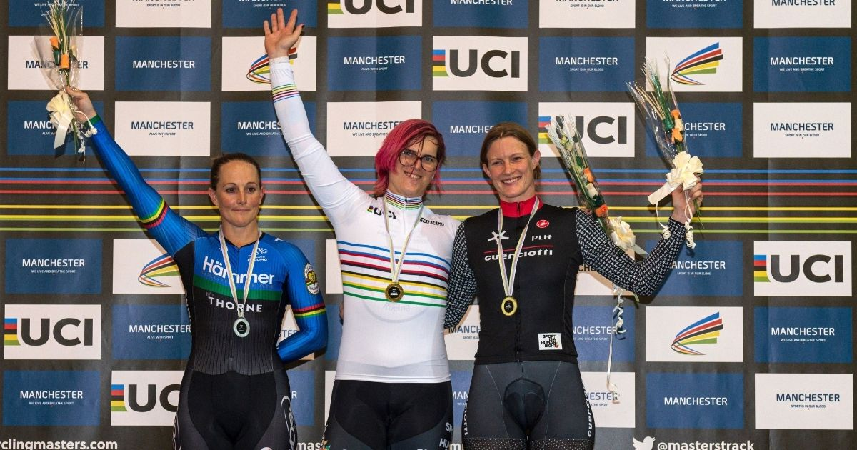 Transgender Canadian cyclist Rachel McKinnon, center, celebrates his gold medal on the podium with bronze medalist Kirsten Herup Sovang, right, of Denmark and silver medalist Dawn Orwick, left, of the United States, at the UCI Masters Track Cycling World Championships in Manchester, England, on Oct. 19, 2019.