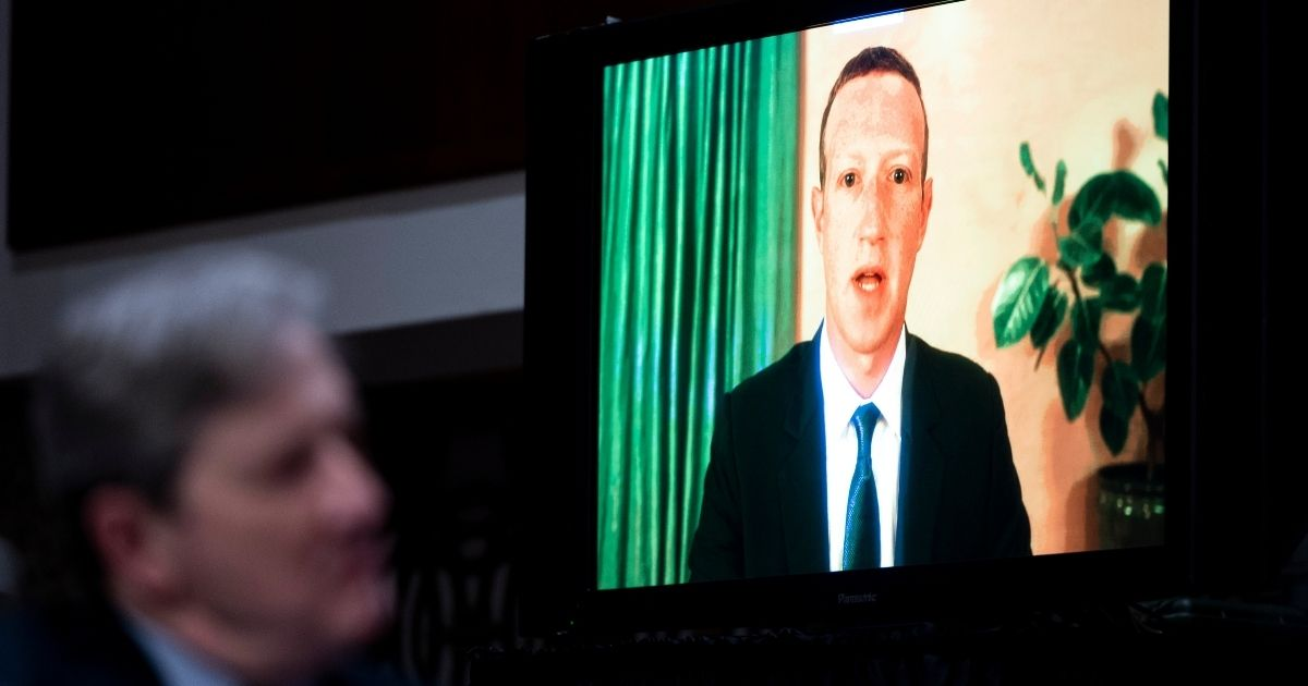 Facebook CEO Mark Zuckerberg testifies remotely as Sen. John Kennedy, a Republican from Louisiana, looks on during the Senate Judiciary Committee hearing on 'Breaking the News: Censorship, Suppression and the 2020 Election' on Nov. 17, 2020, in Washington, D.C.