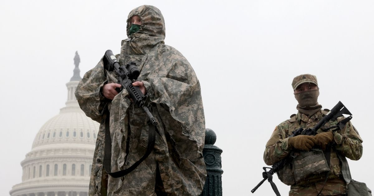 National Guard troops stand guard outside the Capitol on Saturday in Washington.